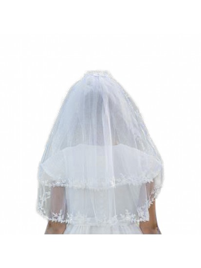 A beautiful two tier white tulle Holy Communion veil...