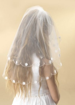 A beautiful two tier white tulle First Holy Communion veil.
