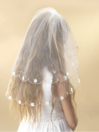 A beautiful two tier white tulle First Holy Communion veil....